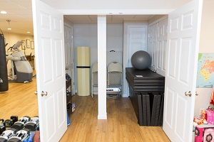 TBF finished basement with home gym in Sparta